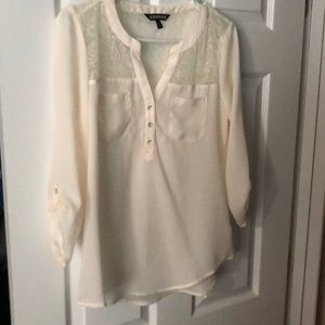 Barely worn cream colored blouse